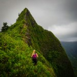 Woman hiking on a ridge in Hawaii