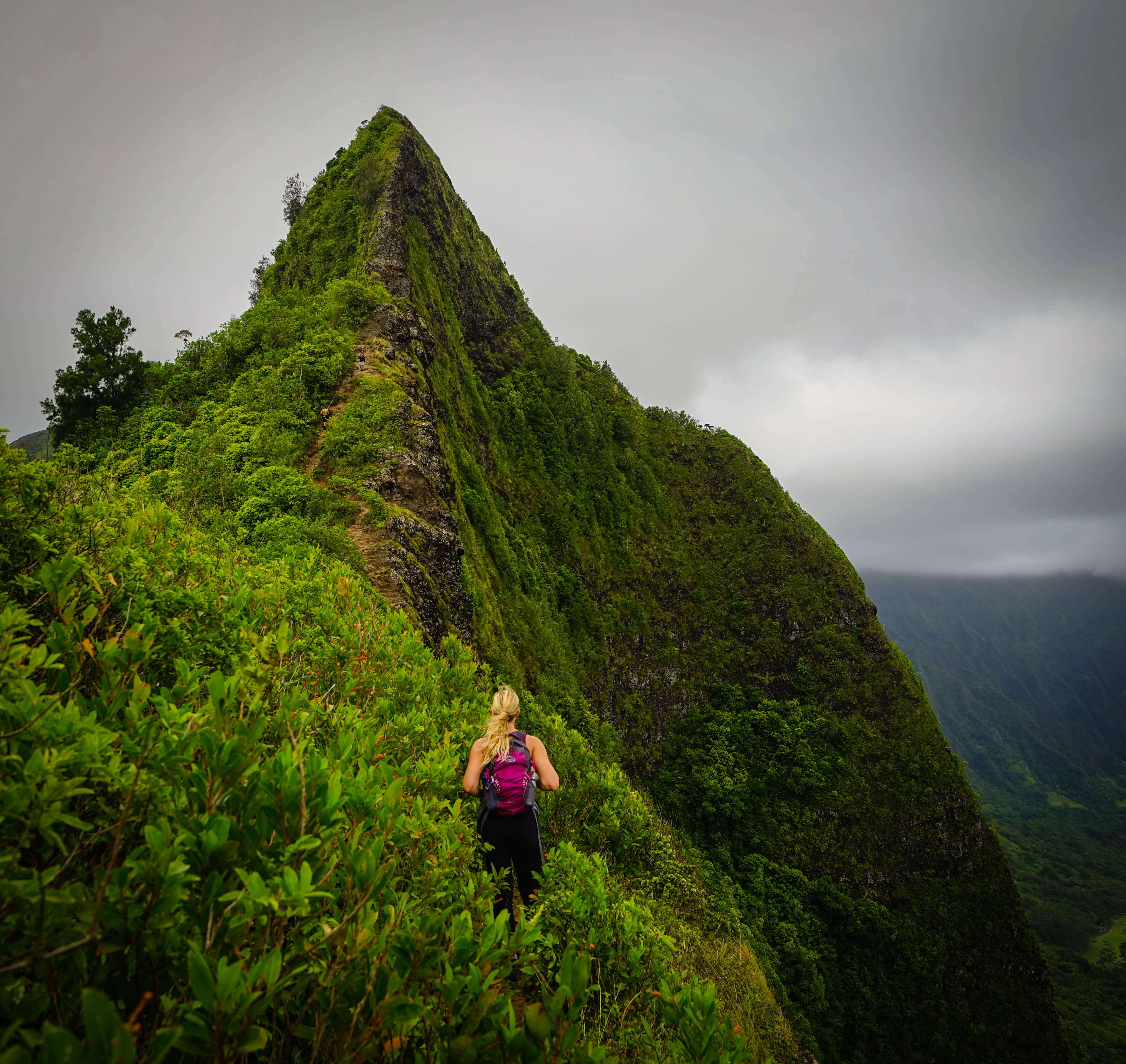 Woman hiking on a ridge in Hawaii
