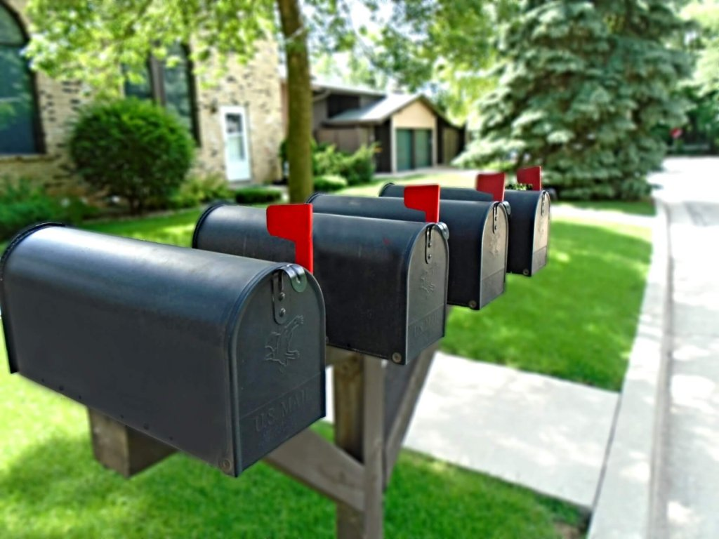 picture of 4 mailboxes on a street
