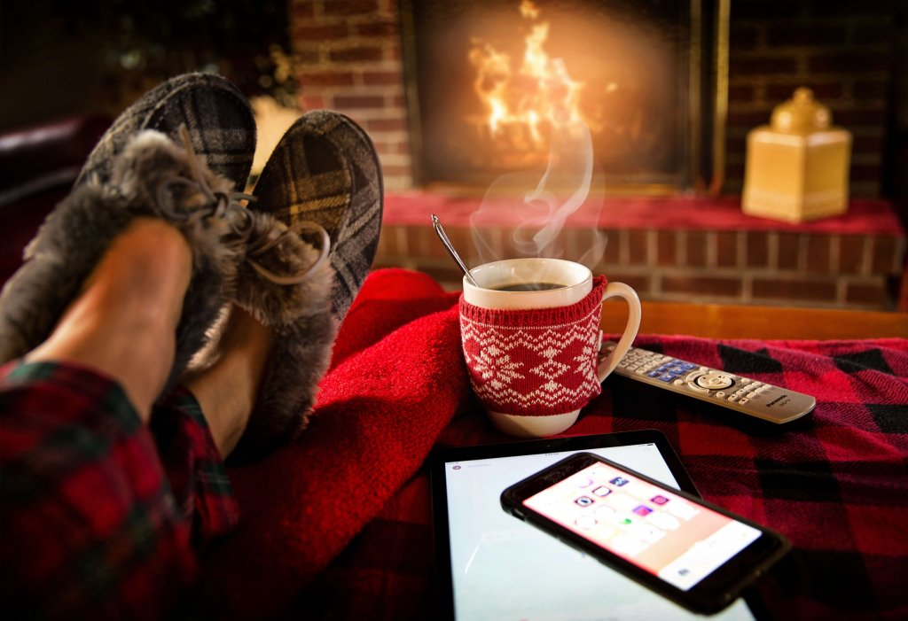 a cup of coffee and a fireplace