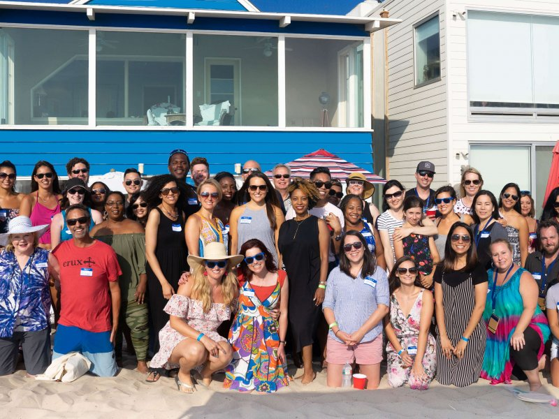 group of traveling therapists in front of a beach house