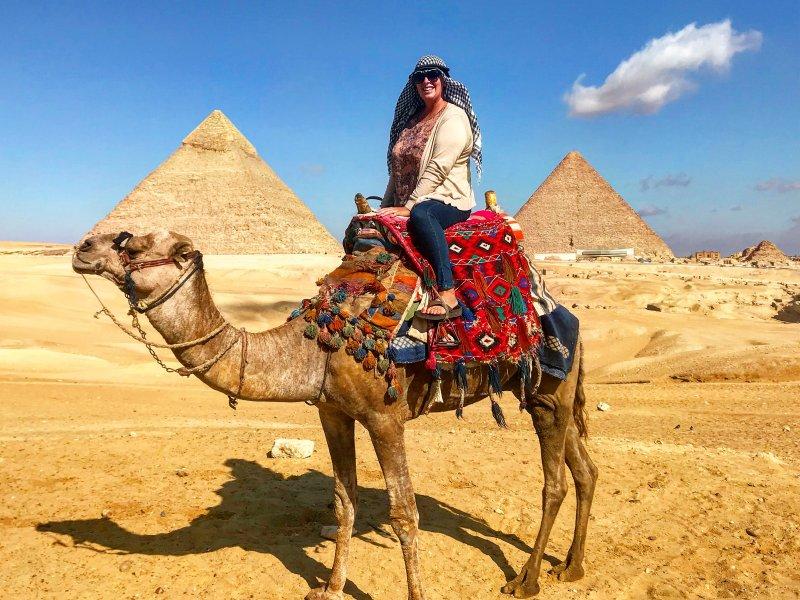 women riding a camel