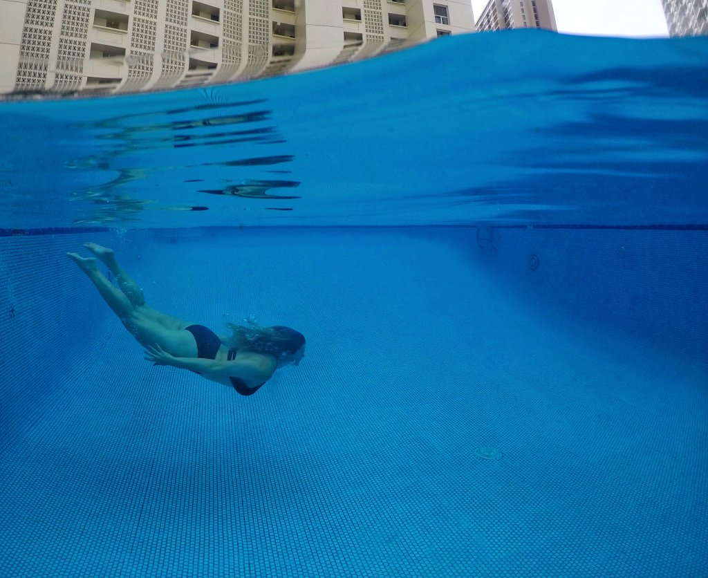 a women swimming in a pool