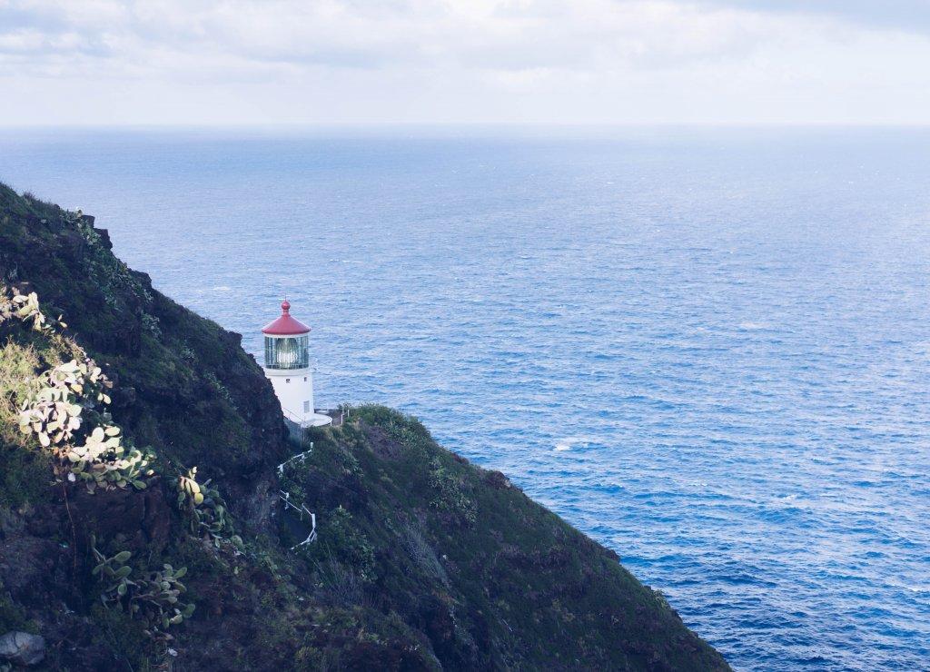 a lighthouse on the ocean edge