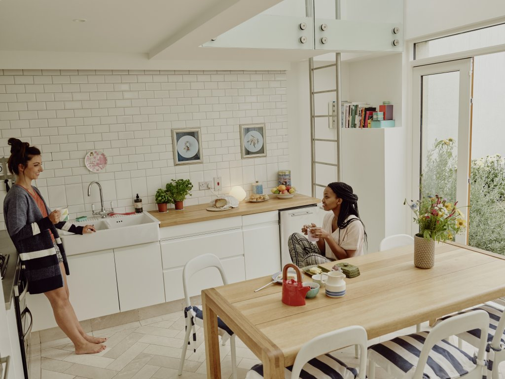 women talking in a kitchen