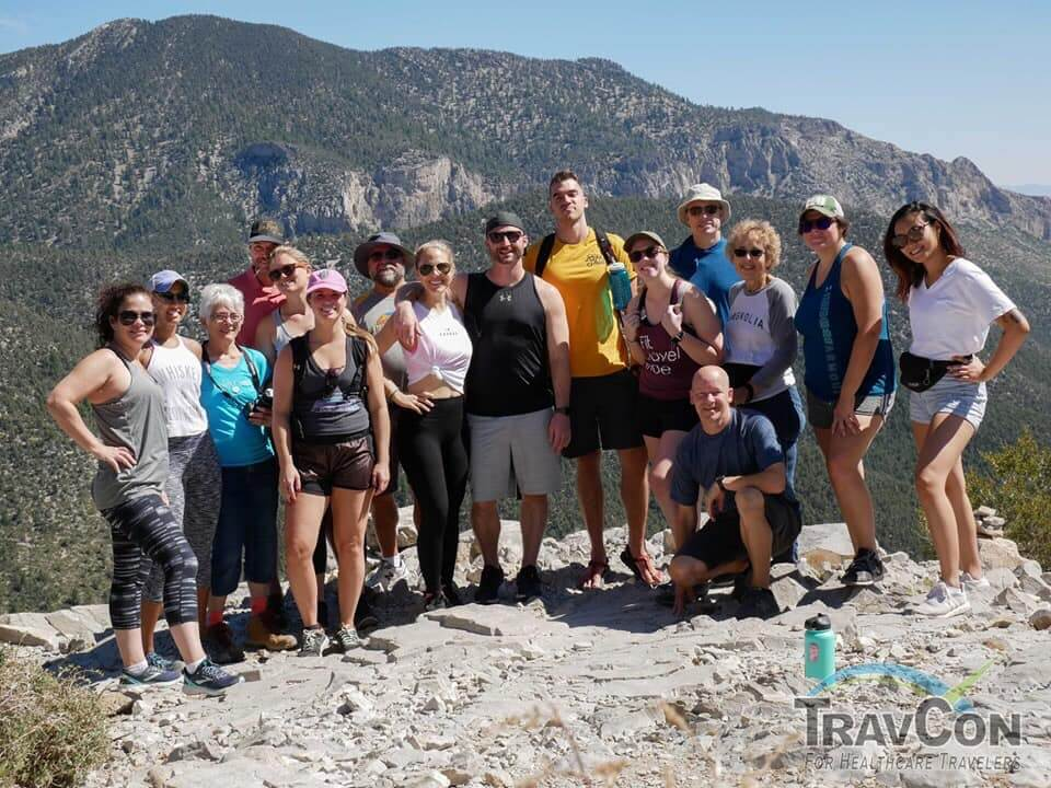 group of people at the top of cathedral rock trail