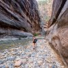 a women on The Narrows Trail at Zion National Park