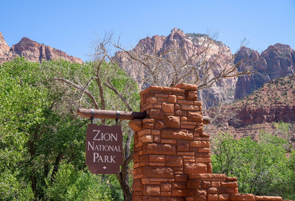 picture of a park sign that says Zion National Park