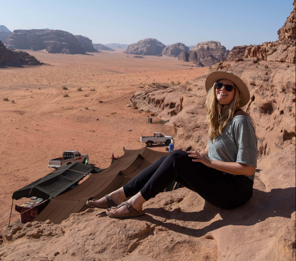 a women sitting in Wadi Rum desert in Jordan