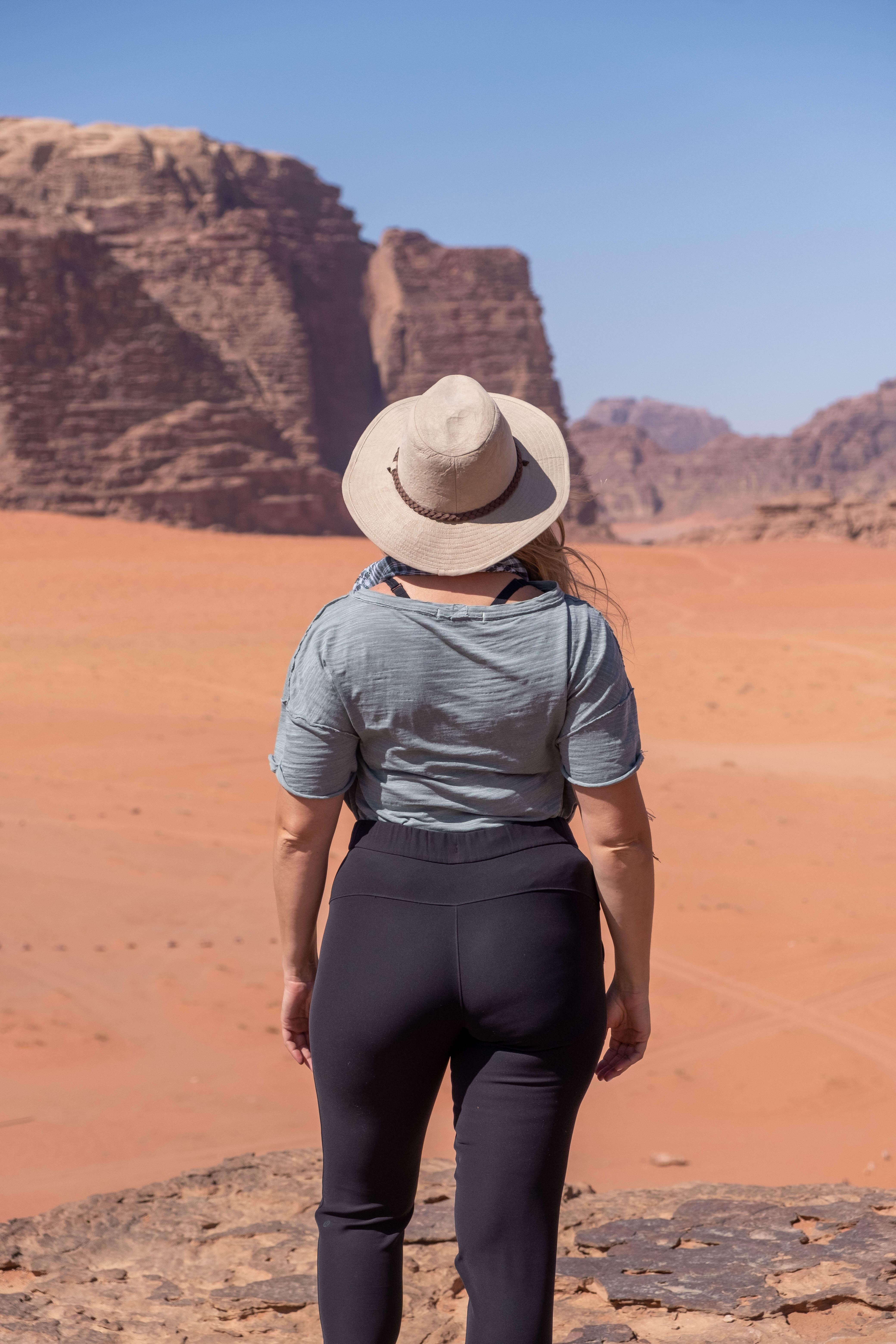 women standing in the desert