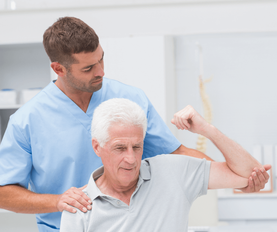 a physical therapist working on a patients arm