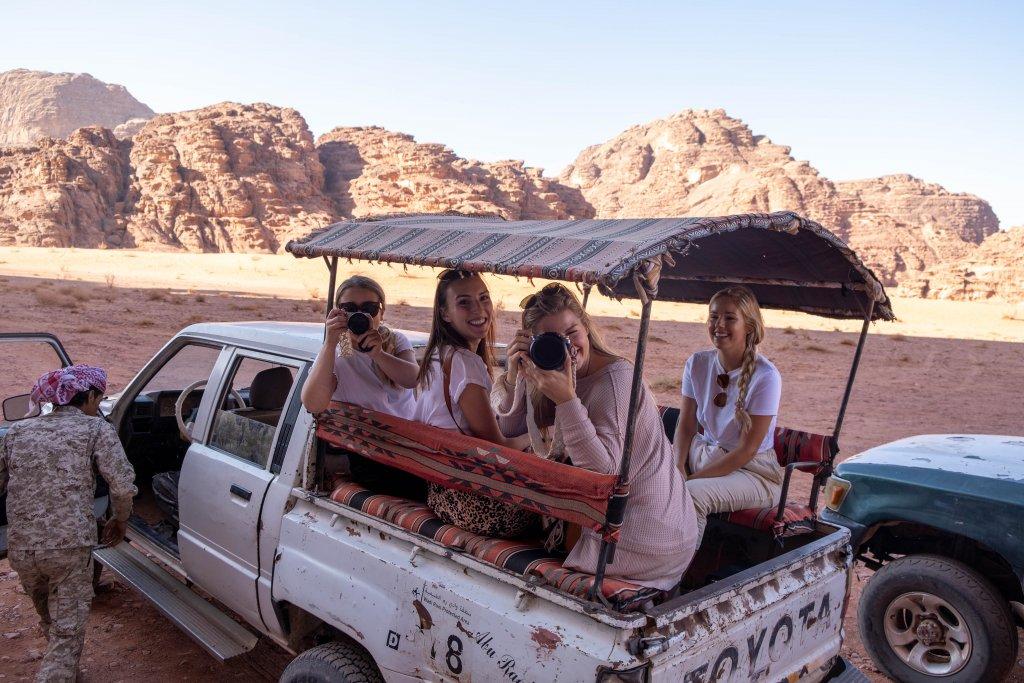 women riding in a truck