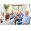 a group of adults doing a group therapy session with a clinician