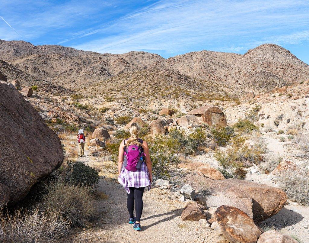 a women walking in a park