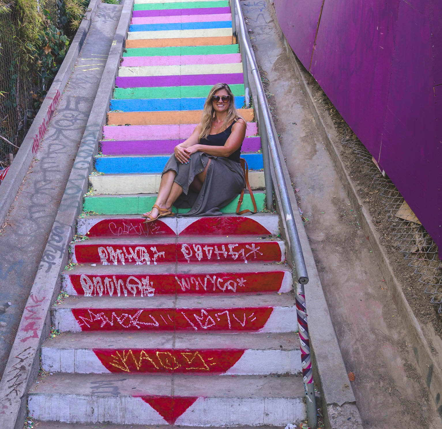 a women sitting on stairs