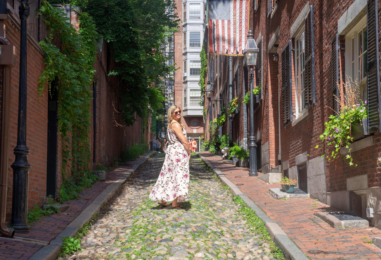 a women standing on acorn street in Boston, MA