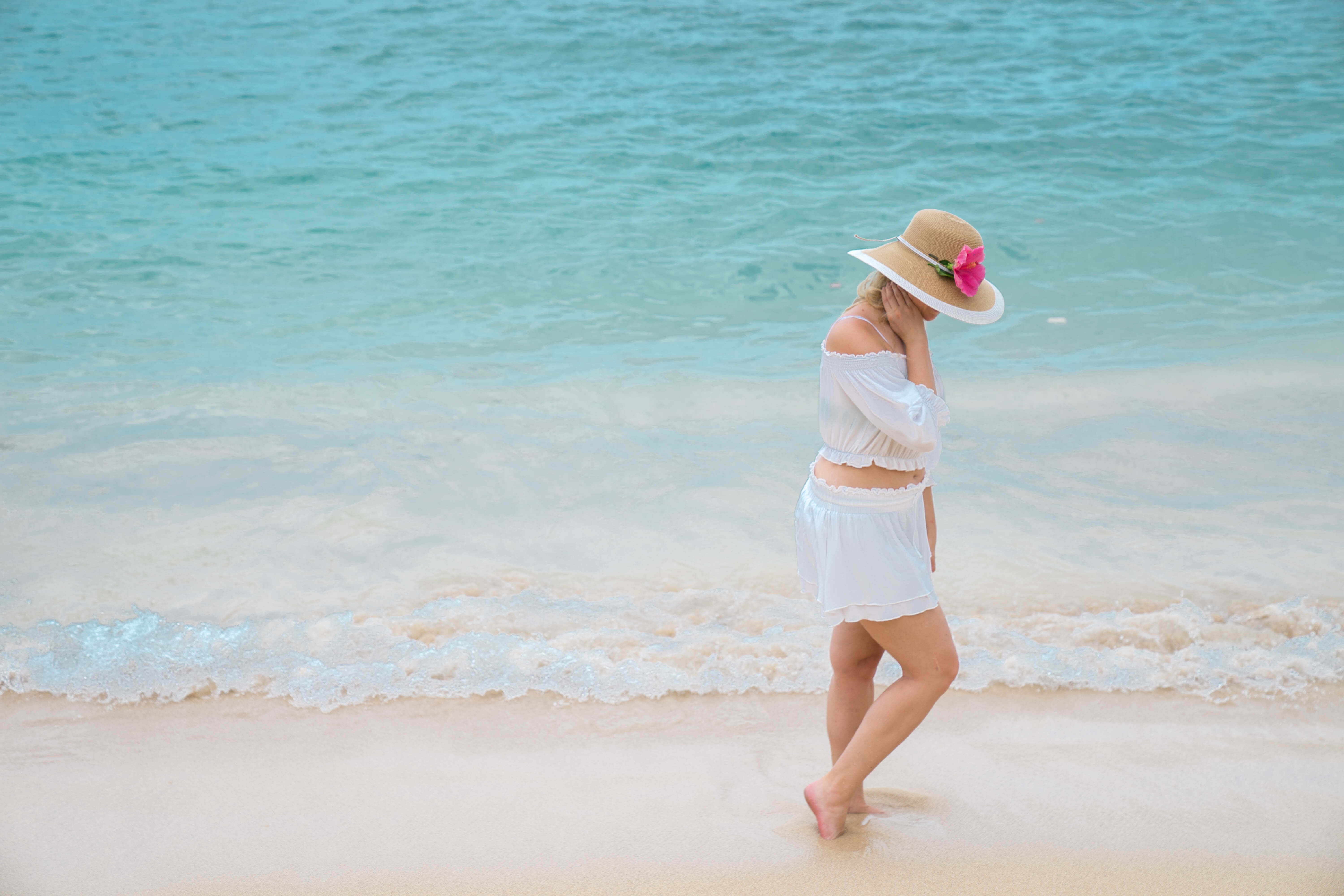 a women walking down Waikiki Beach