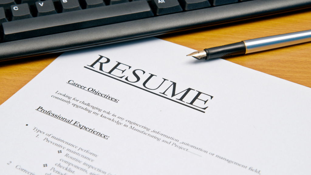 a picture of a resume on a desk