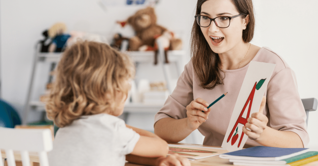 a speech-language pathologist working with a student in the educational setting
